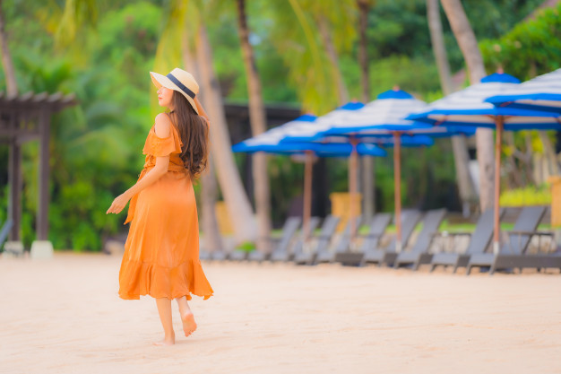 portrait beautiful young asian woman happy smile relax beach sea ocean 74190 8661
