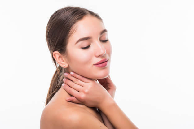 beautiful sensual woman touching her face isolated white wall beauty skincare concept spa 231208 1467