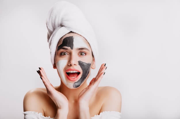 joyful girl with face mask surprise green eyed woman posing white wall after washing her hair 197531 13982