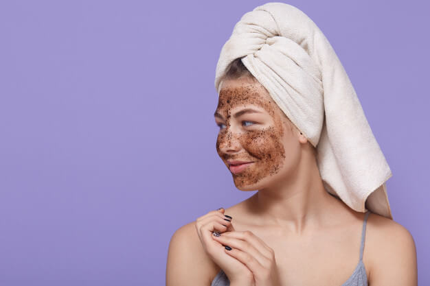 portrait female model applies chocolate mask face has positive expression looks aside 176532 10644