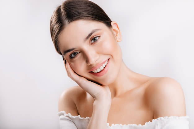 portrait smiling girl with healthy skin cute dark haired woman white wall 197531 13800