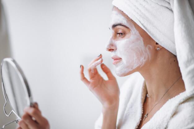 woman applying beauty mask 1303 13041