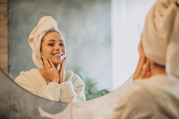 woman home applying cream mask 1303 24618