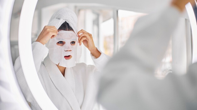 young woman using beauty face mask 23 2148837484