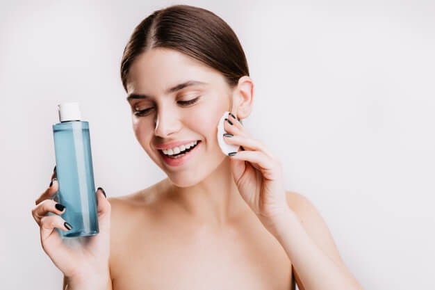 female model with snow white smile without make up poses white wall demonstrating beneficial properties micellar water 197531 13873